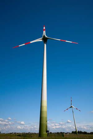 Wind turbines in fields of rye photo