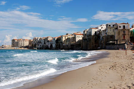 Beautyfull view at calm city beach in Iatly Cefalu photo
