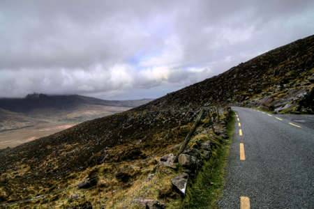 Beautifull pass in hills of Dingle serpentine road photo