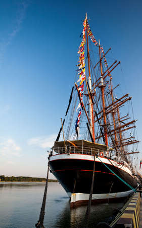 Tall ship in Klaipeda port cloudless sky  photo