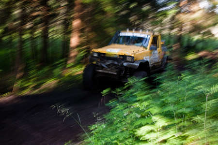 4x4 truck driving trough mudy track in bloory motion Stock Photo - 5638288
