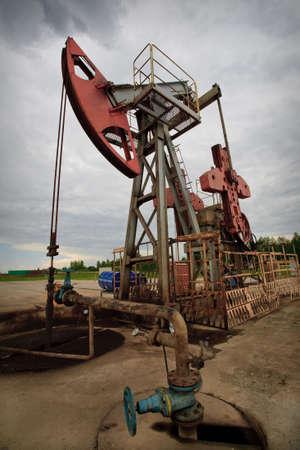 Oil rig pump closeup low angle view photo