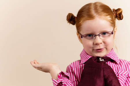 Girl redhead elegant with glasses against slightly purple background showing various facial expresions and copy paste space photo