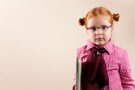 colour intensity: Girl redhead elegant with glasses against slightly purple background showing various facial expresions and copy paste space