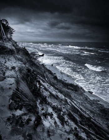 broken hill: Black and white photo of eroded coast at baltic sea due climate change Stock Photo