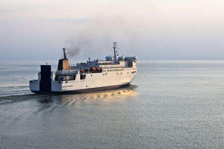 Cruise ferry leaving the port on quite summer evening Standard-Bild