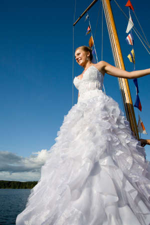 Happy bride on yacht agaisnt clear blue  sky Stock Photo - 6422649