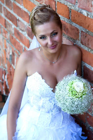 Natural looking portrait of bride with floers bouquet Stock Photo - 6422653