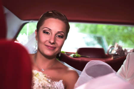 Beide going in a car to wedding ceremony
