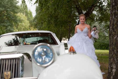 Bride vintage car preparation for wedding ceremony