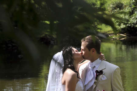 Groom kissing the happy bride photo