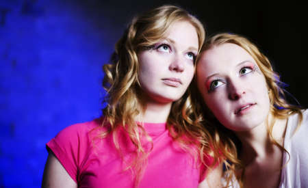 Two teenage girls on blue background lit with 4 flashes Stock Photo - 7411254