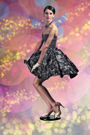 Woman pin-up style on multicolour bokeh background photo