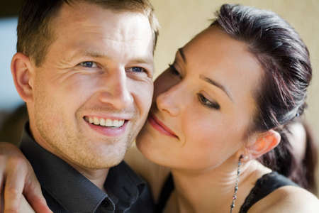 Young women hugging man with secret in her eyes Stock Photo - 8113943