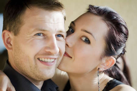 Young women hugging man with secret in her eyes