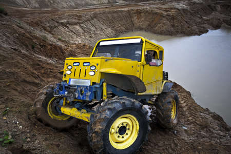 4x4 truck driving in sand quarry on scarp Stock Photo - 8113945