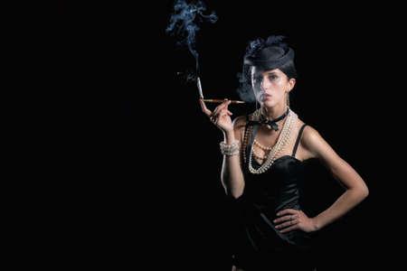 Woman with cigarette vintage hat photo