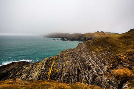 Irish coastline cliff landscape fog photo