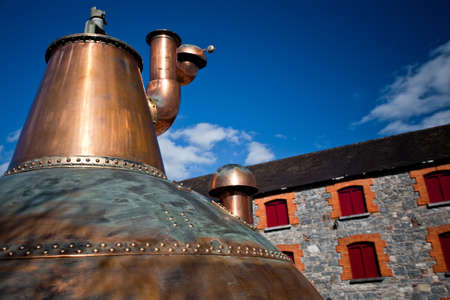 whisky distillery stills in Ireland near distillery photo