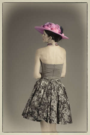 Young woman from behind vintage hat and style photo