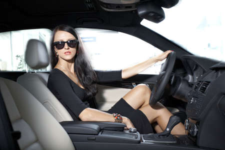 Sexy woman in luxury car with long legs Stock Photo - 17892540