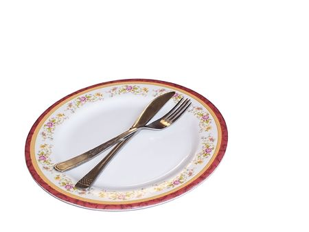 photo of a plate with a floral pattern having a fork and a knife on it Stock Photo - 717096