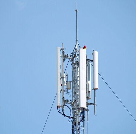 intercommunication: gsm antenna on blue sunny sky         Stock Photo