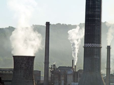 a factory polluting air during work process       Stock Photo - 1282296