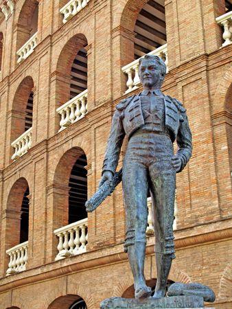 bronz: Bronz toreador and the spanish corrida behing