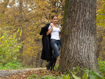 attractive women and the forest in autumn photo