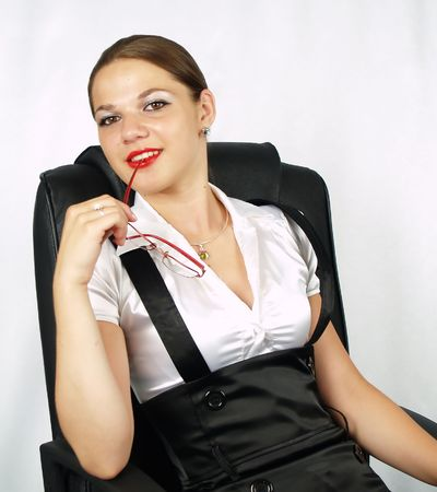 successfull: attractive business woman with red glasses