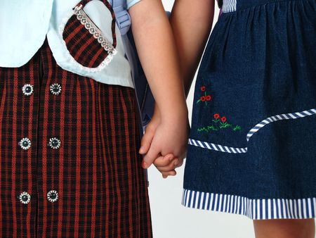 girls holding hands: closeup school girls holding hands Stock Photo