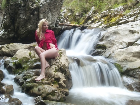 sexy blonde posing near the river photo