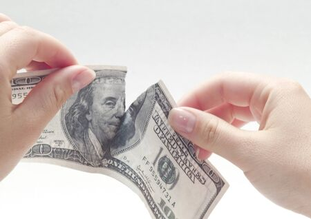 ripping one hundred dollars  photo