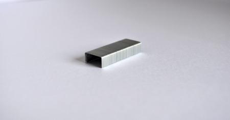 staples: Silver staples on white background