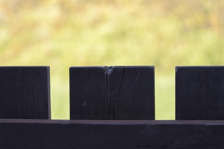 fence with dark wood and old flower background Stock Photo