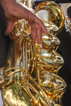 Musician playing saxophone at Easter Stock Photo