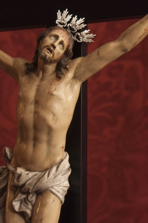 jesus crucified on a red background