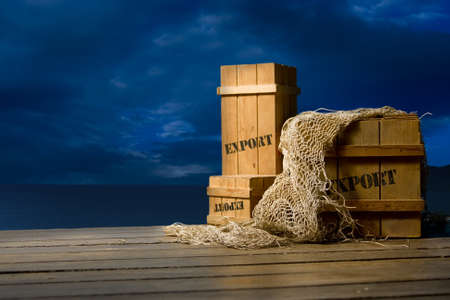 exported: wooden crates on a dock at night Stock Photo