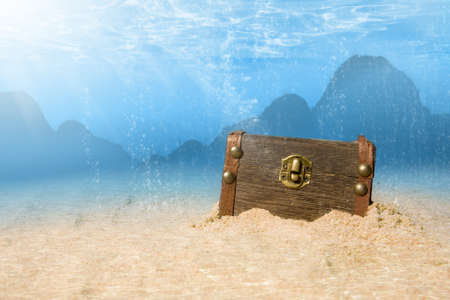 photo of treasure chest submerged underwater with light rays Stock Photo - 9389057