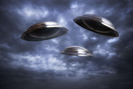 invasion: Photo of three UFOs flying in the sky Stock Photo