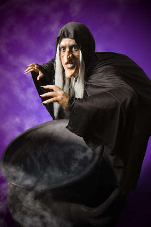 wicca: Halloween witch with her cauldron