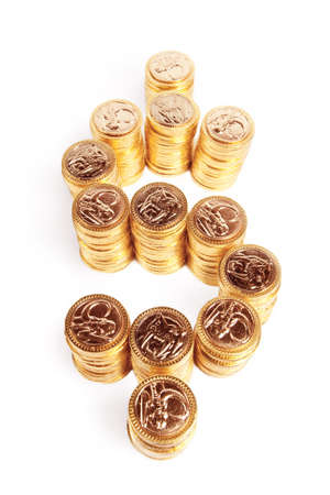Stack of coins piled in form of money sign Stock Photo - 9435673