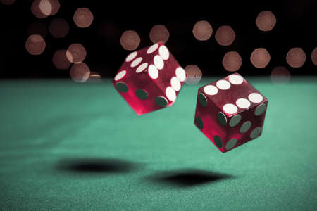 two dice rolling on table photo