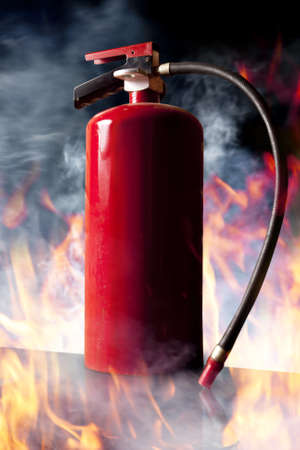 Fire extinguisher with flames Stock Photo