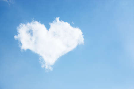 Photo of a Cloud-shaped heart on the sky photo