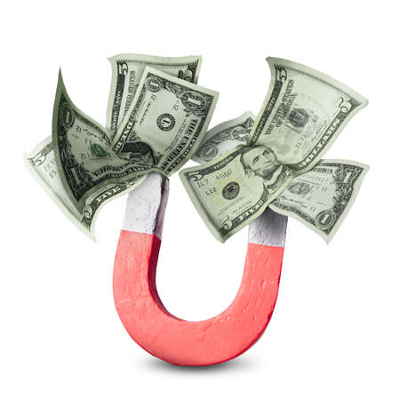 A horseshoe magnet collecting money over white. Stock Photo - 9437450
