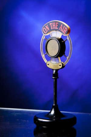 loudspeaker: radio microphone on blue background