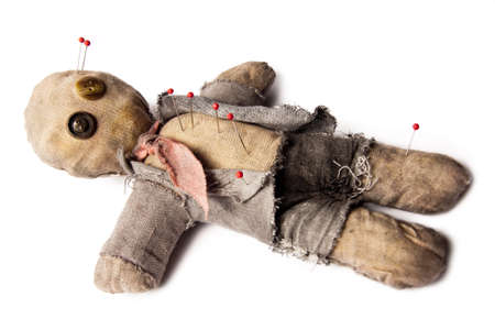 business man voodoo doll with needles laying on white photo
