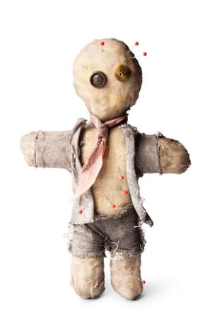 voodoo doll: business man voodoo doll with needles on white